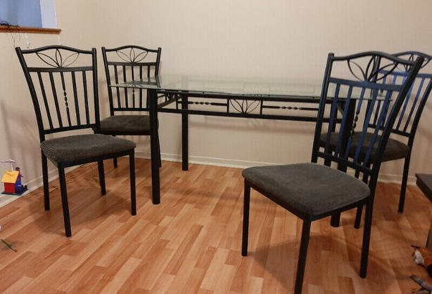glass top black metal dining table with 4 chairs
