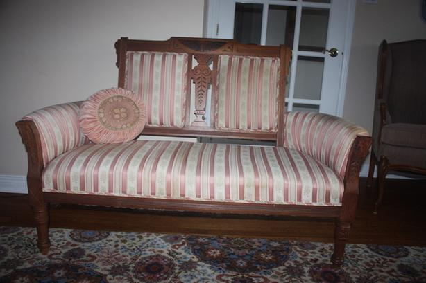 Antique love seat and rocking chair