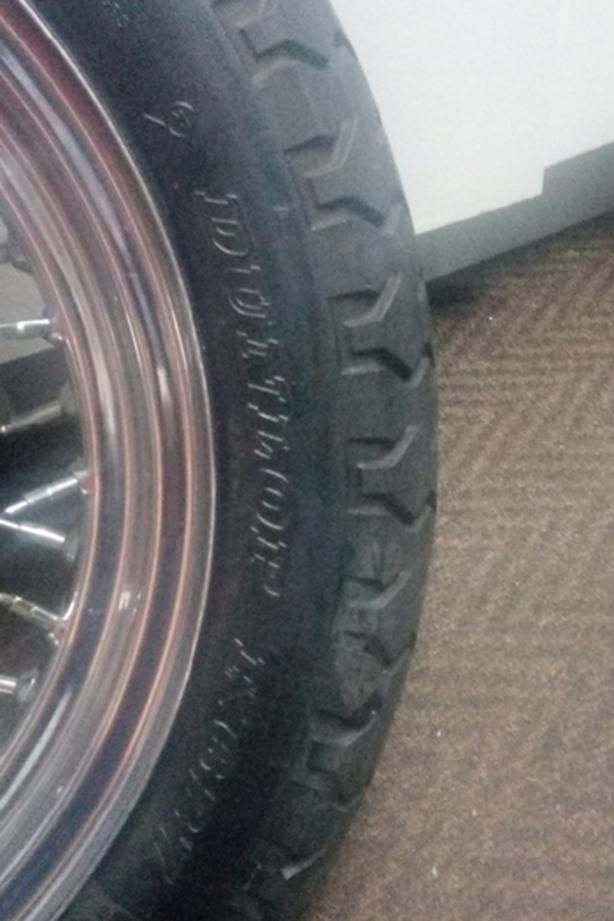 130 90 16 Dunlop tire on rim