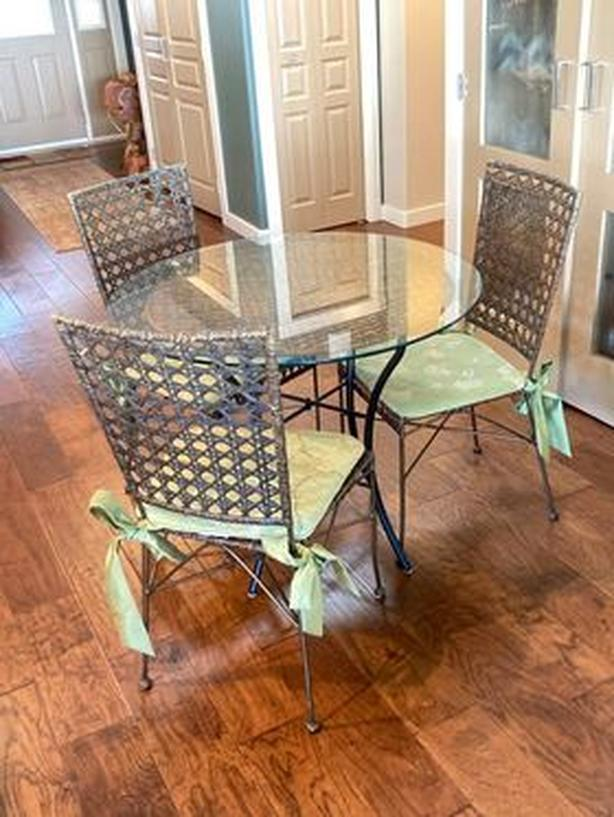 Large 3 ft dia. glass dining / kitchen table and three chairs