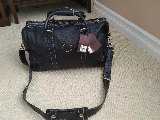 Brand new Genuine leather Roots bag ($528 with tax at store)