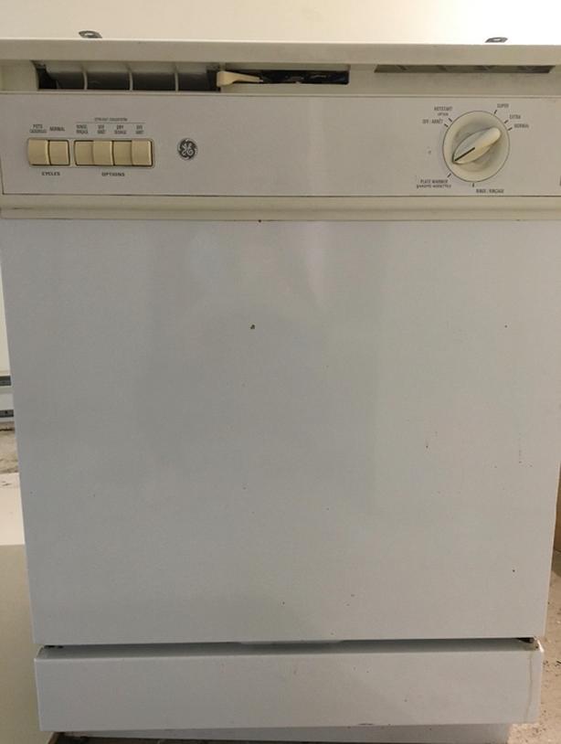 """White GE 24"""" dishwasher"""
