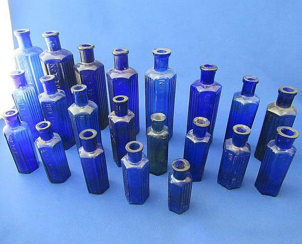LOT OF ANTIQUE BLUE HEXAGONAL POISON BOTTLES AT STEPTOE AUCTION
