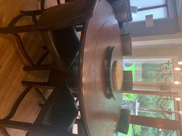 solid wood dinning table, hutch and 8 chairs