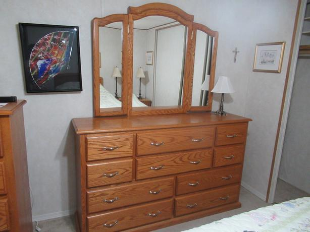 Almost new custom made solid oak 10 drawer dresser w/ mirror