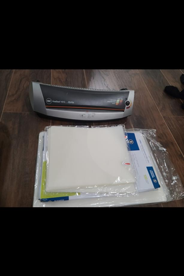 GBC HeatSeal H312 laminator with huge amount of laminating sheets