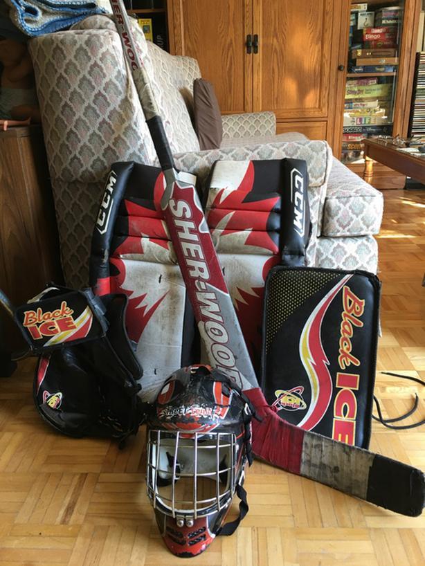 hockey goalie pads, glove, blocker, helmet, goalie stick,