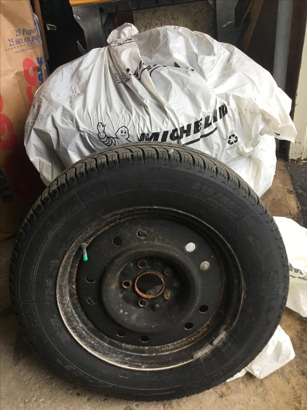 215/ 65R 16 Michelin X-ICE Winter Tires on rims for