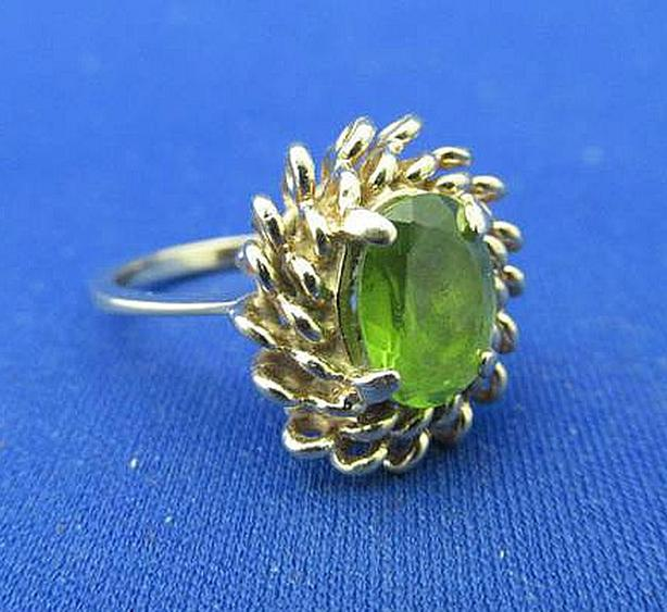 WOMEN'S 14K GOLD RING SET WITH GREEN STONE AT STEPTOE AUCTION