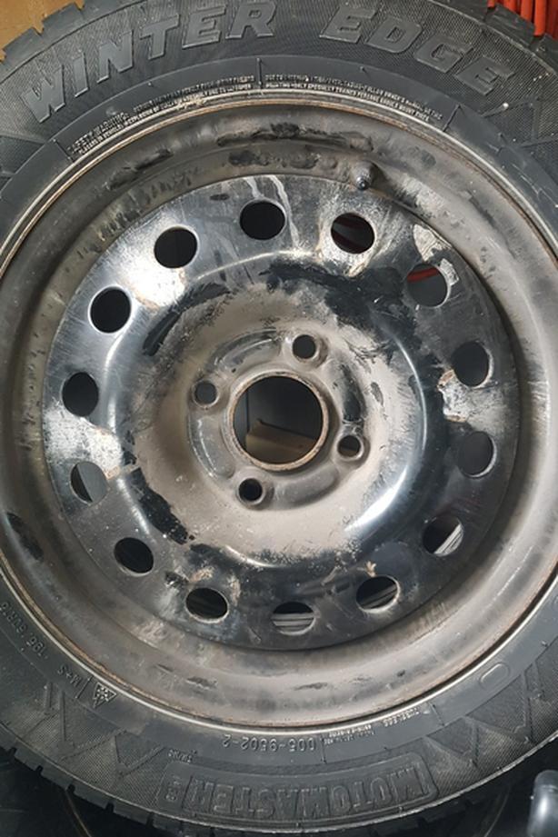 Motomaster Winter Edge tires on rims.