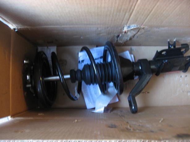 01-05 Honda Civic front pas. side strut assembly