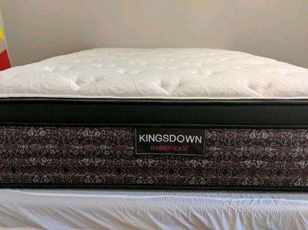 Kingsdown full mattress + box spring + free Bed frame on wheels