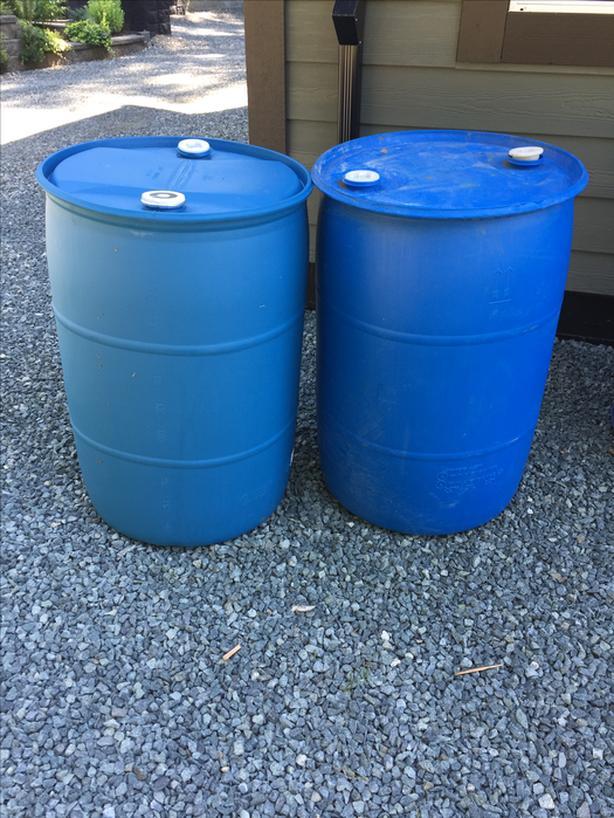 55 and 20gallon blue/black plastic barrels