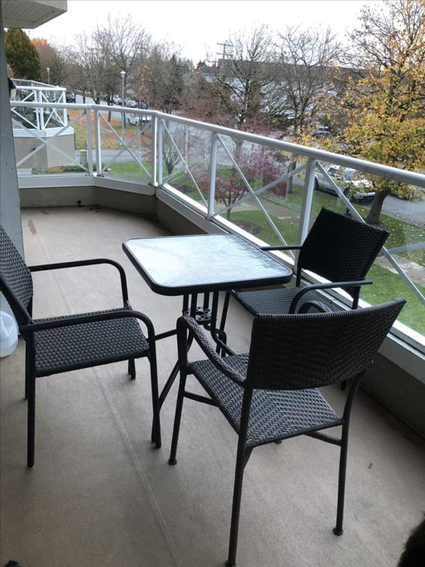 glass and metal table and 3 chairs