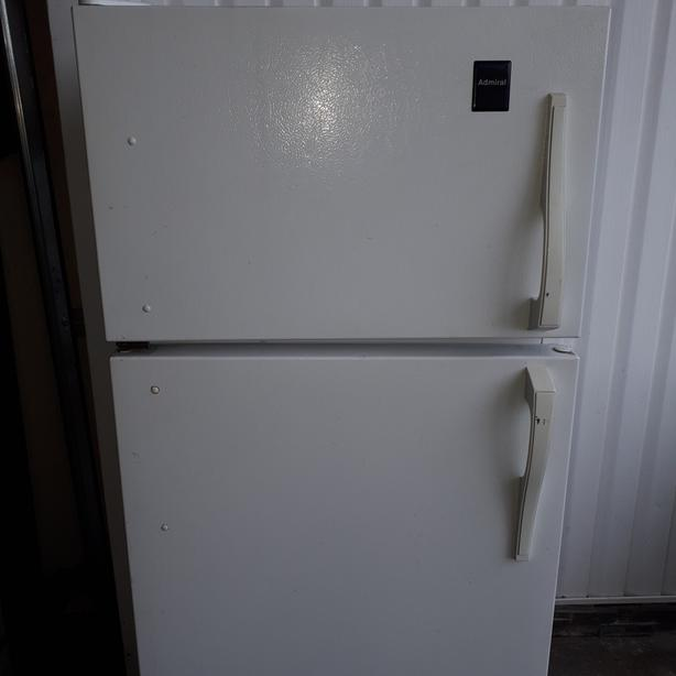 """Made by GE Apartment size fridge, 24"""" wide and 59 1/4"""" height"""