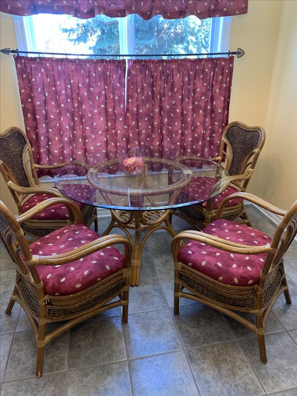 rattan and glass kitchen table and four chairs