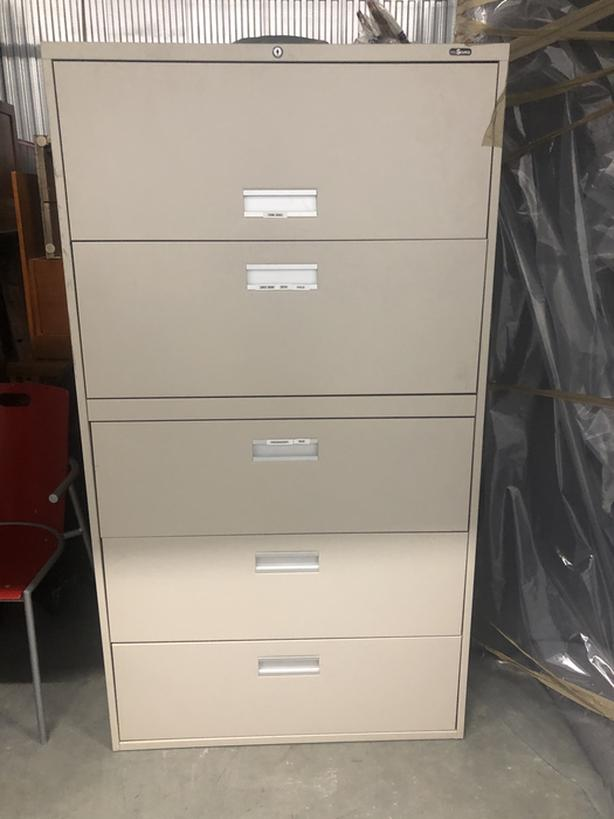 Large filing cabinet with key.