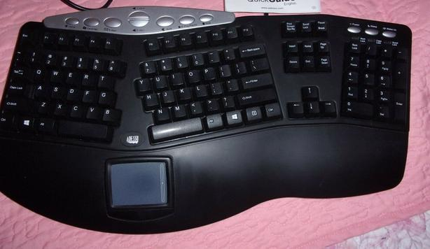Ergonomic contoured keyboard with integrated touchpad