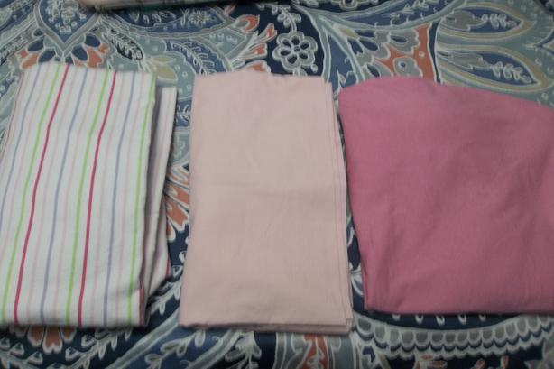 3Crib sheets,4 blankets (1 brand new) all for $20.00