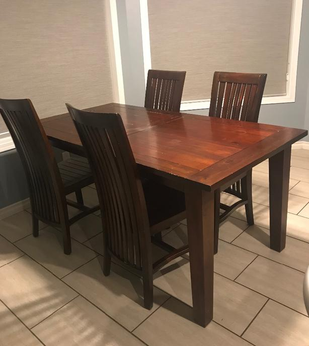 solid wood dining or kitchen table with 4 chairs