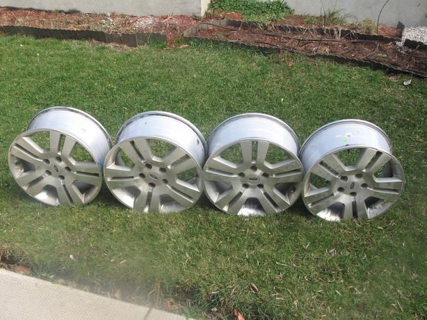 FOUR (4) 17 INCH FORD ALLOY RIMS - $150