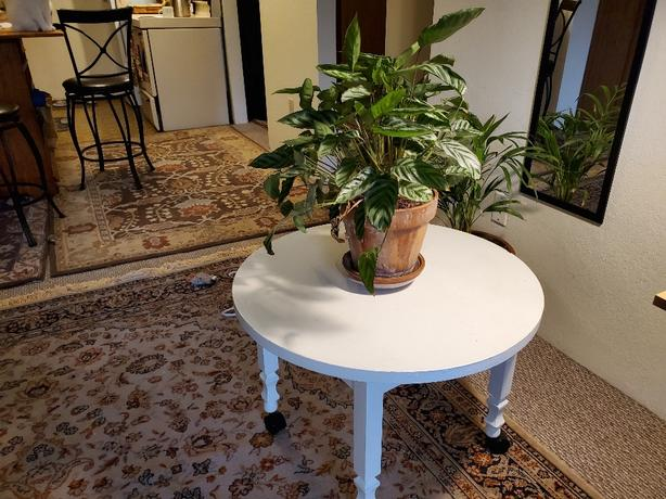 solid round wood coffee or end table on castors