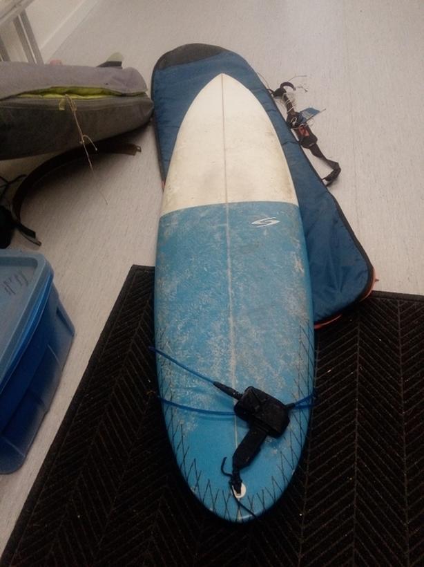 7'0 Surfboard  with travel bag FCS fins amd leash