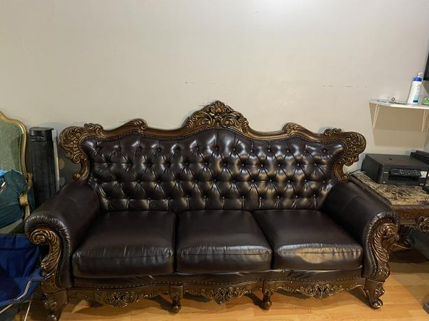 Dark leather with Beautiful wood detailing sofas