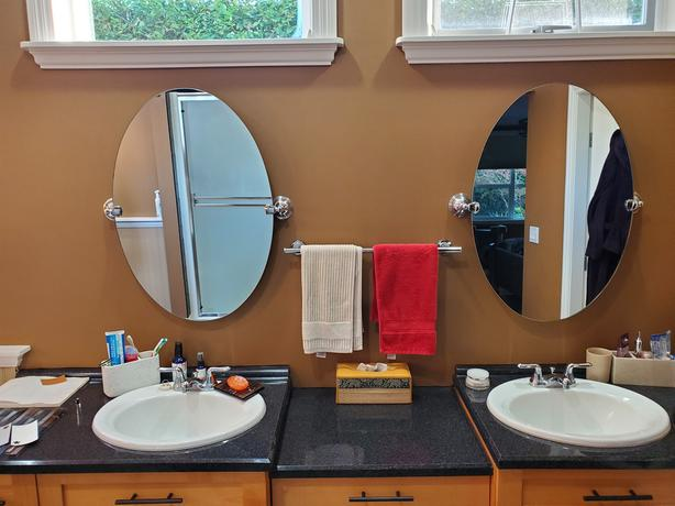 2 EUC pivoting bathroom mirrors