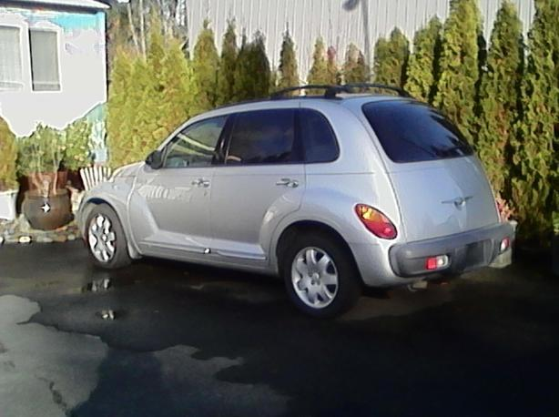 2002 Silver PT Cruiser in near mint condition.