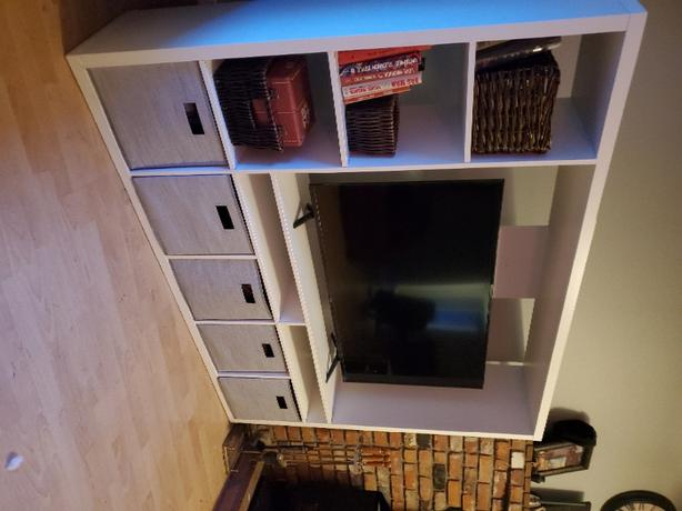 TV, entertainment center and storage boxes
