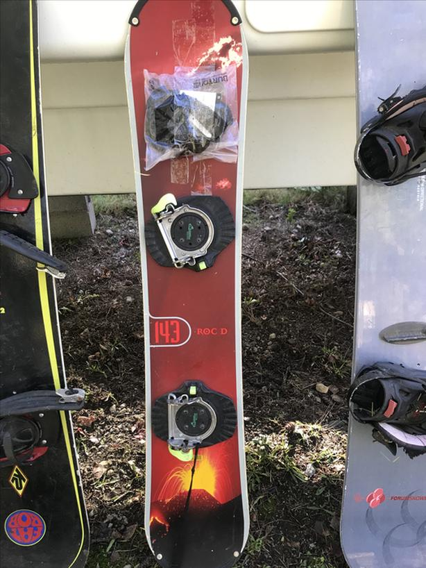 Red snowboard with bindings