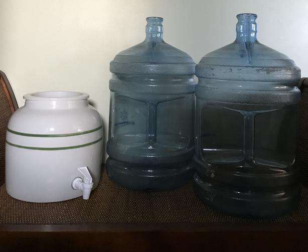 ceramic water dispenser and 5 gallon water jugs