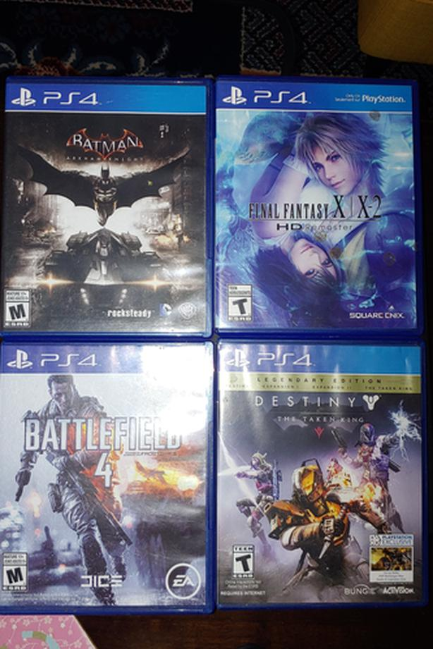 PS4 w/4 games and 2 controllers for sale!