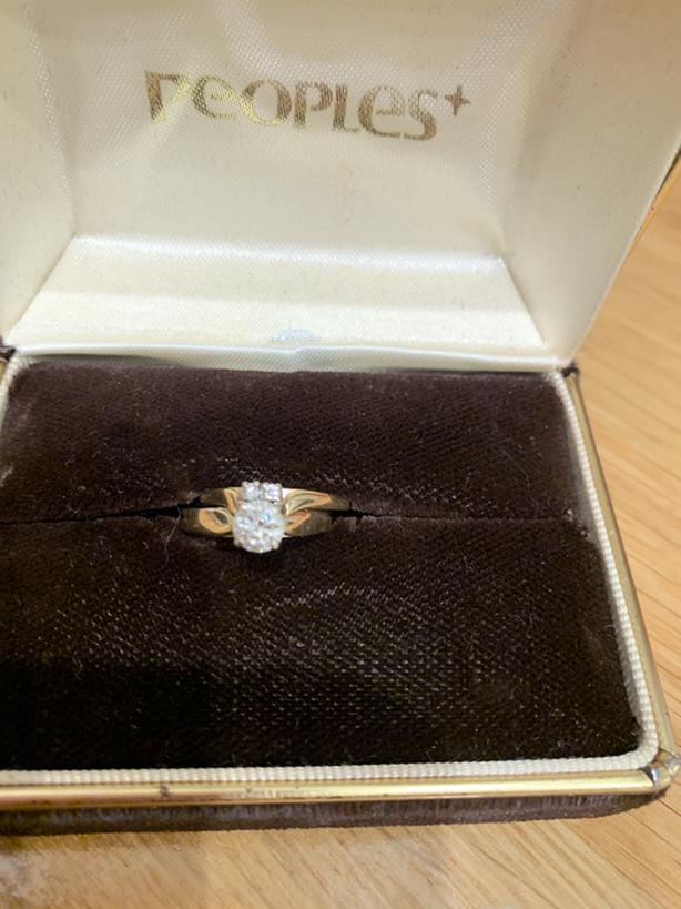 Gold engagement ring with matching gold wedding band