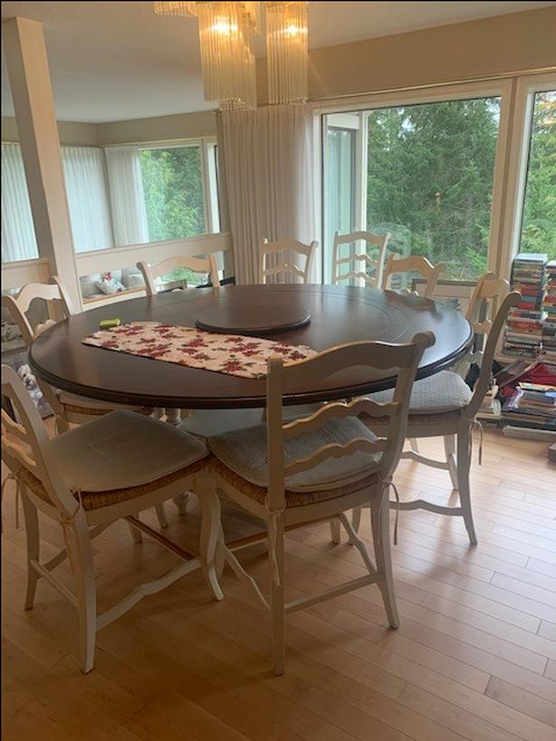 Large round table with 8 chairs, 1 large brown hutch ..
