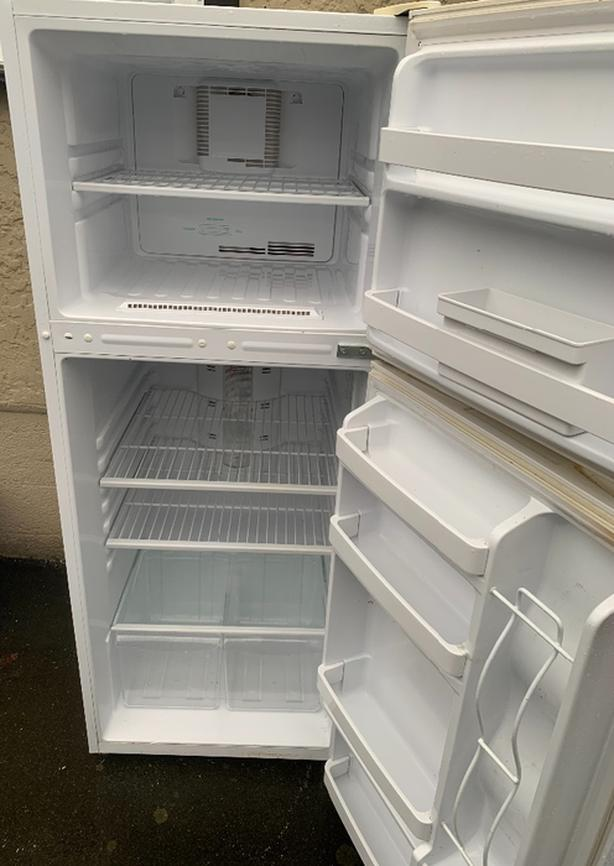 GE fridge, apartment size, works great, clean.