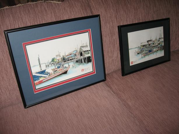 Lot of two (2) framed prints of a Malaysian Fishing Village Signed 1993
