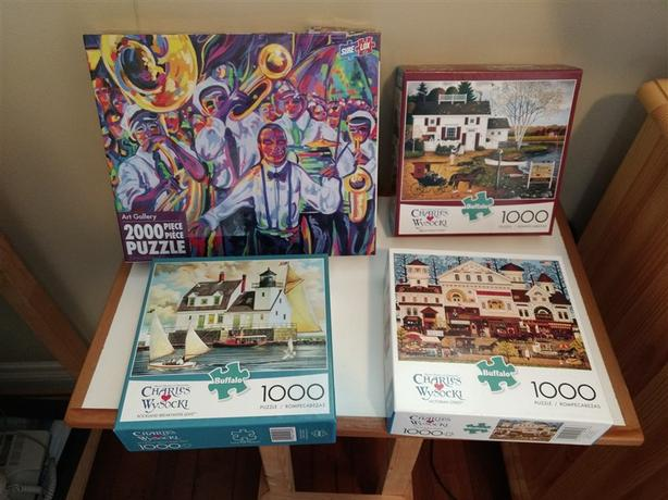 Four almost new jigsaws