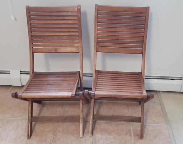 Four folding teak chairs