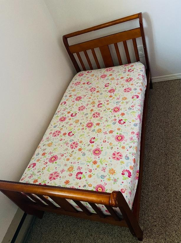 toddler bed with mattress and covers