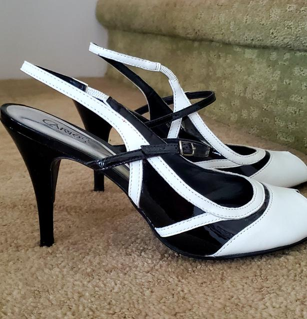 Black and white open-toed Spectator pumps