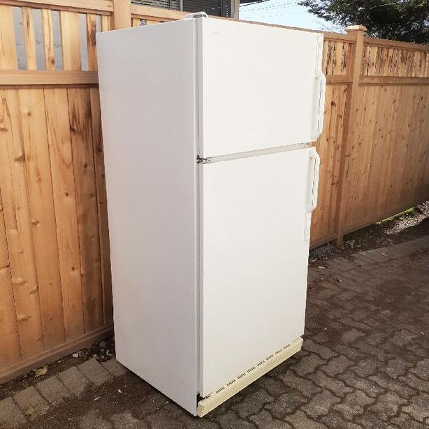 Family size fridge good name in appliances and good working order