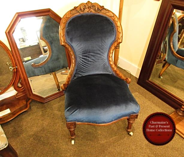 GORGEOUS ANTIQUE CARVED FIRESIDE CHAIR AT CHARMAINE'S