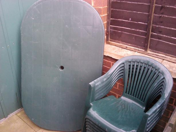 green plastic patio table 6 chairs garden outside black