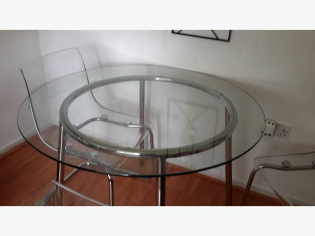 Ikea Round Glass Dining Table And 4 Clear Chairs Outside