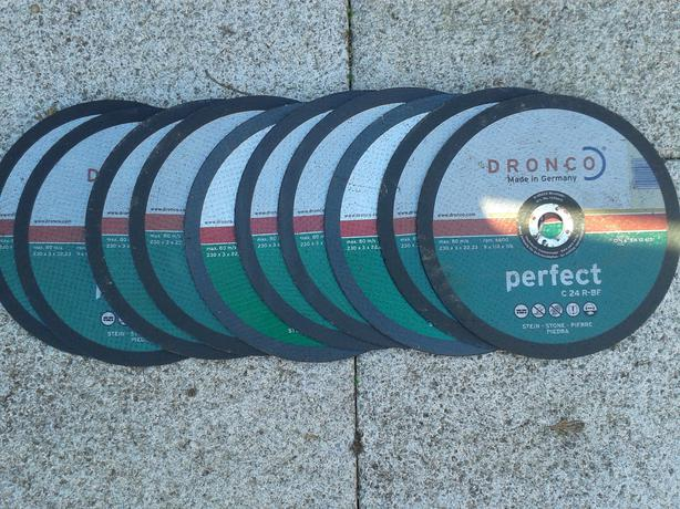 16 stone and metal disc blades of different sizes
