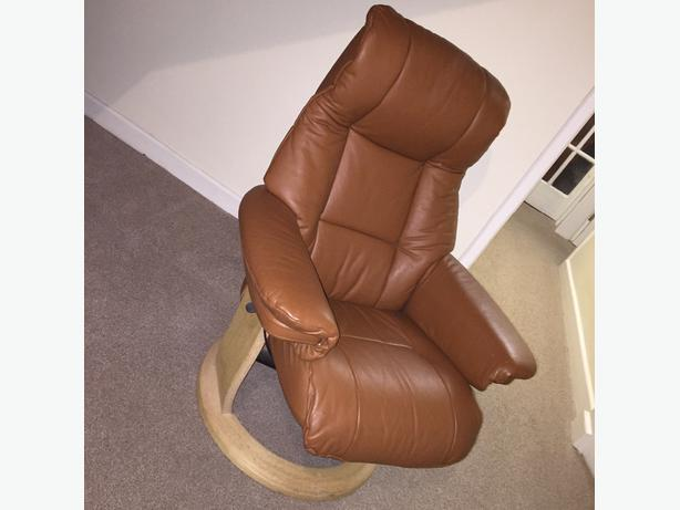 brown leather reclining chair with foot stool
