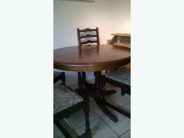 log in needed 50 solid dark oak dining table and four chairs