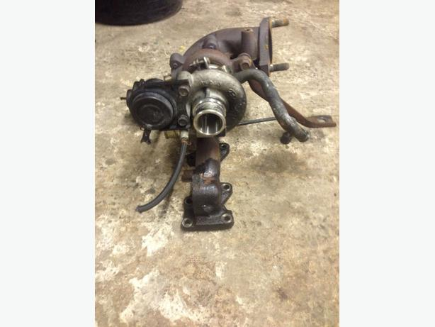 KIA CARENS CRDI 2002-2006 2.0 TURBO AND EXHAUST MANIFOLD 74,012 MILES